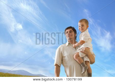 Father and 2 years old baby boy looking at the future.