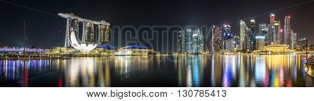 Panorama of the marina and financial district of Singapore by night