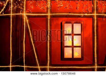 House in Christmas decoration, outdoor, nightshot.