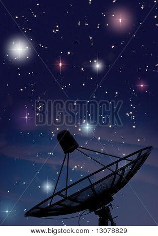 Satellite dish under starry night sky