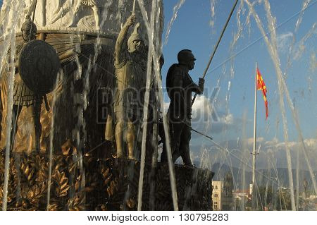 Macedonia Skopje detail of the Alexander the Great monument-fountain Macedonian national flag in the background poster