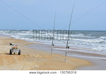 Surf fishing tackle on the beach at Florida, USA.