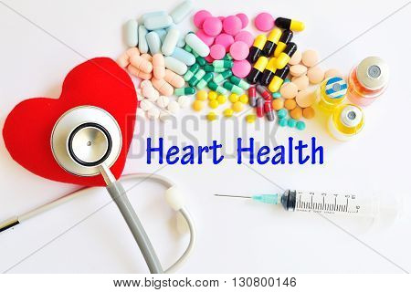 Syringe with drugs for heart disease treatment, medical concept