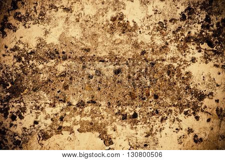 Dull concrete wall with peeling paint for use as background