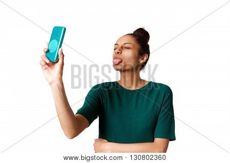 Young Woman Sticking Out Her Tongue And Taking Selfie