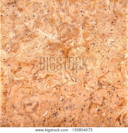 Pinkish-tan stone background with a swirled pattern square