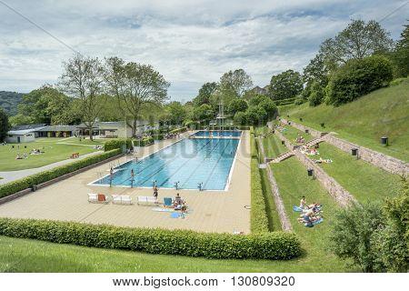 BADEN-BADEN, GERMANY  - MAY 22, 2016: Summer swimming pool in Baden-Baden. Summer swimming pool popular destination family recreation.