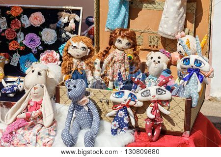 HRODNA BELARUS - MAY 21 2016: Exhibition sale of dolls on Sovetskaya street in historic city centre Grodno Belarus
