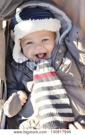 Portrait Of Smiling Cute Little Baby Boy Wearing Warm Winter Hat And Clothes. Happy Child Concept.