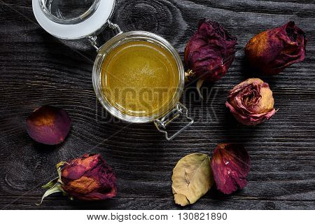 honey in a glass jar on a wooden background