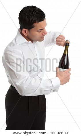 Sideview Man Or Waiter Opening Bottle Of Champagne