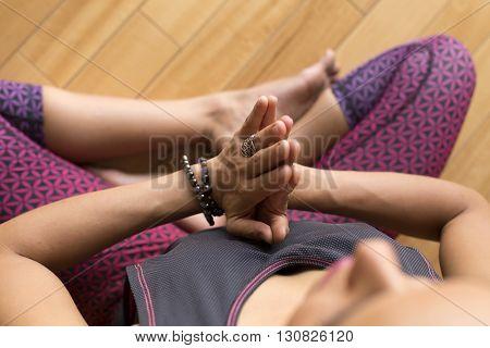 Closeup of a woman's hands during meditation