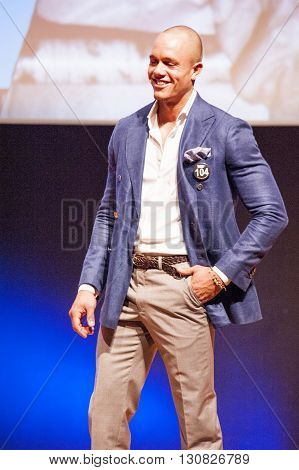 MAASTRICHT THE NETHERLANDS - OCTOBER 25 2015: Male fitness model dressed in suit shows his best on stage at the World Grandprix Bodybuilding and Fitness of the WBBF-WFF