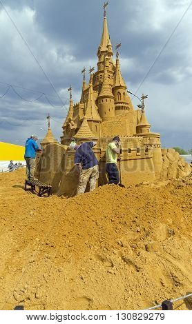 MOSCOW RUSSIA - May 1 2016: The exhibition of sand sculptures in Kolomenskoye Park. Completion of work on the creation of a sand sculpture. The composition of