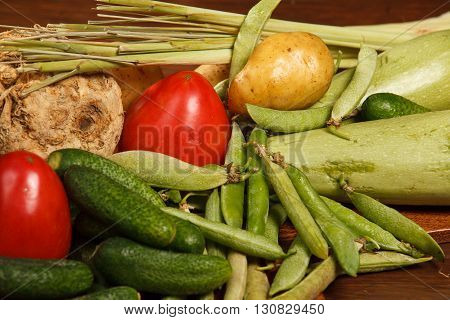 Many different vegetables on the wooden brown table