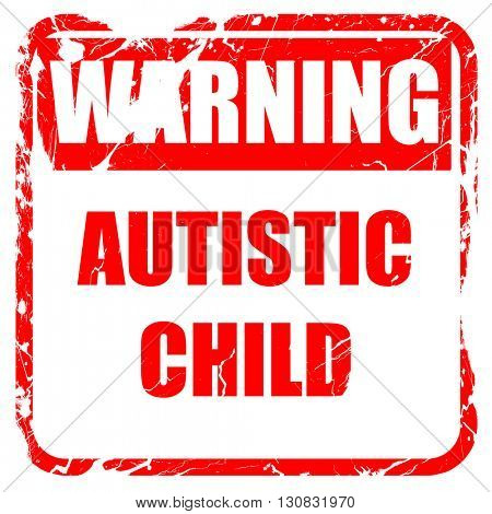 Autistic child sign, red rubber stamp with grunge edges