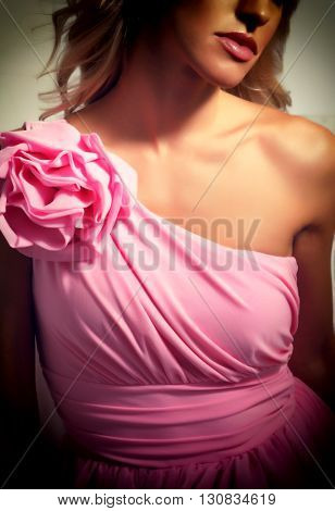 Beautiful blonde girl in evening dress pink