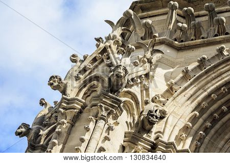 Paris, France - May 13: These are architectural fragment of tower of Notre Dade de Paris with the statues of little chimeras May 13, 2013 Paris, France.