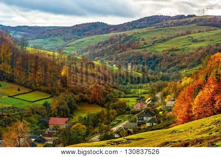 Village Falls On Hillside With Autumn Forest In Mountain