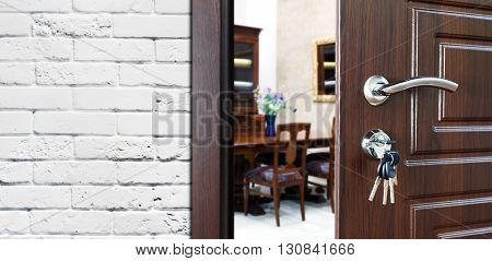 Half opened door to a cabinet or office. Door handle, door lock. Lounge door half open. Opening door. Privacy, welcome concept. Entrance to the room. Door at white brick wall, modern interior design.