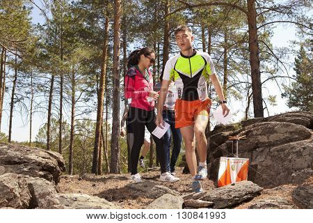 RUSSIA, ULAN-UDE - MAY 22, 2016: Russian Azimut - 2016. Orienteering competition is held annually in the Buryatia region. People at at control point at orienteering course.