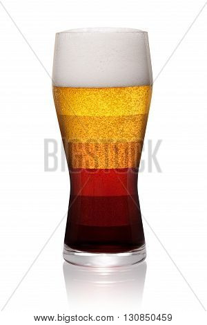 Different types of beer shown in one glass isolated on white background. With clipping path