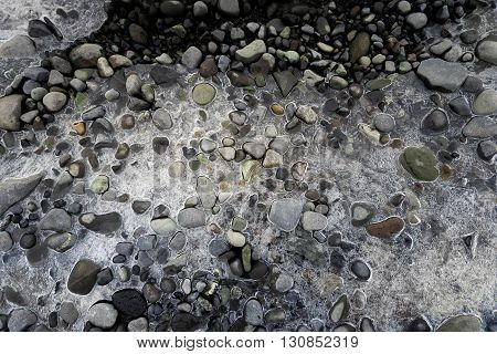Ice and stones frozen togather at the shore