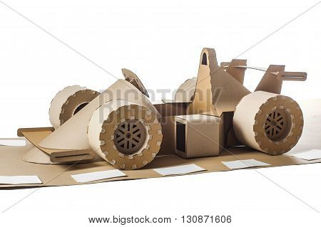 Photo of cardboard racing car on white background