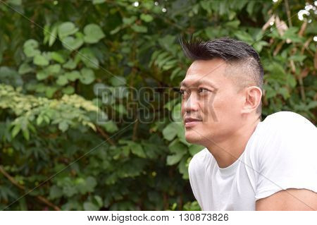 Asian Man posing outdoor looking at the scenery