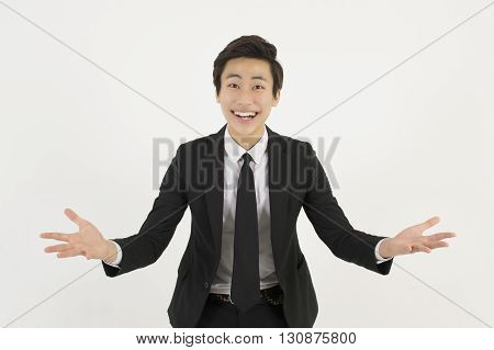 Successful business young man spreading his arms