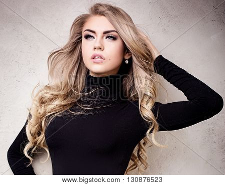 Young Sexy Blonde Girl Posing In Studio.