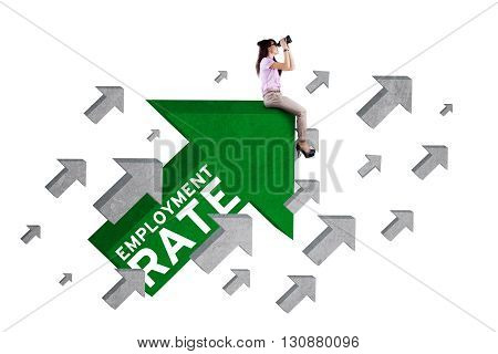 Photo of female work hunter sitting on the upward arrow sign with employment rate text and using binoculars isolated on white background