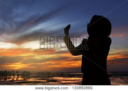 Silhouette Of Woman Praying