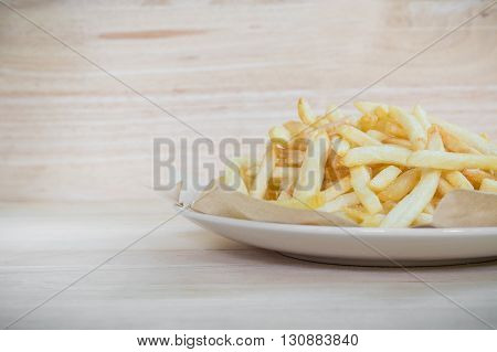 Homemade french fries potatoes on wood surface
