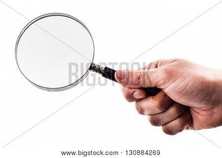 Holding A Magnifying Glass Over White
