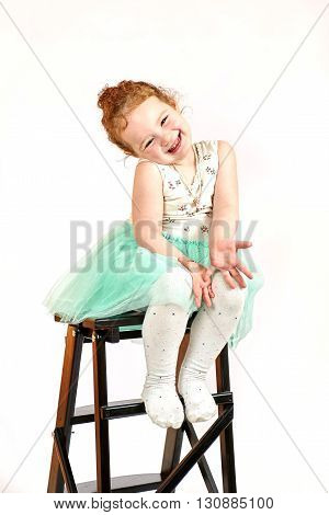 Fashion little girl in green dress in catwalk model pose stock photo. Image 08