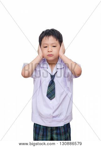Little asian boy in school uniform close his ears by hands over white background