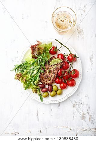 Grilled Beef Steak with Grilled Cherry Tomatoes and Salad