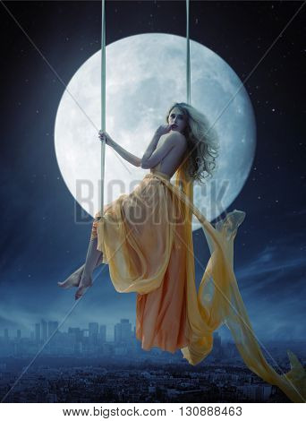 Elegant woman over big moon background