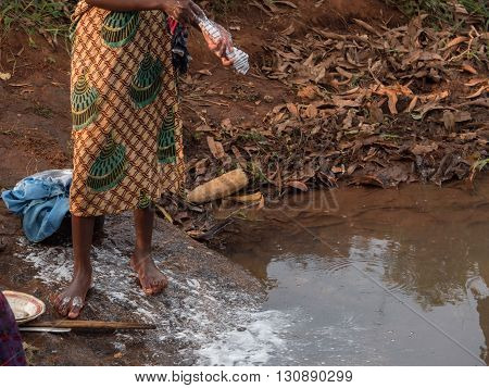 African girl to the river in Malawi