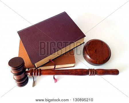 Wooden gavel and law books in the white bg