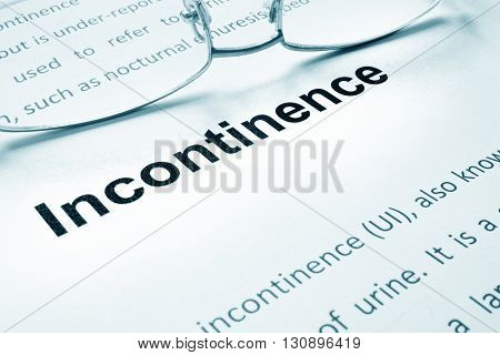 Incontinence sign on a paper and glasses.