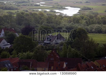 Ribe view from Cathedral Tower - old houses and courtyard gardens. Ribe River in the background Jutland Denmark.