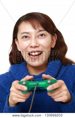 portrait of Asian woman enjoying a video game on white background poster