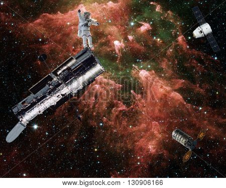 Space rescuers hurry to the aid of the astronaut suffering disaster in the middle of the Milky Way. Collage. Elements of this image furnished by NASA.