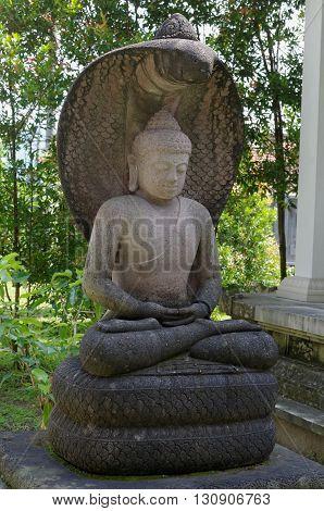 buddha amitabha statue in mendut buddhist monastery