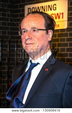 LONDON UK - JUNE 7 2015: French president Francois Hollande in the Madame Tussauds wax museum. Marie Tussaud was born as Marie Grosholtz in 1761