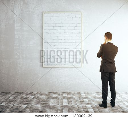 Man Looking At Brick Frame