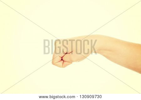 Woman hand with clenched a fist