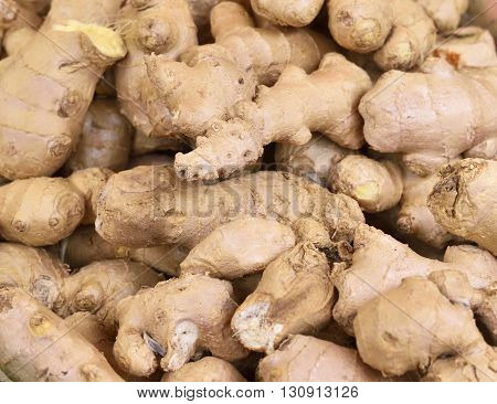 Fresh ginger at a market stall. Selective focus of ginger in a wooden box at a market stall.